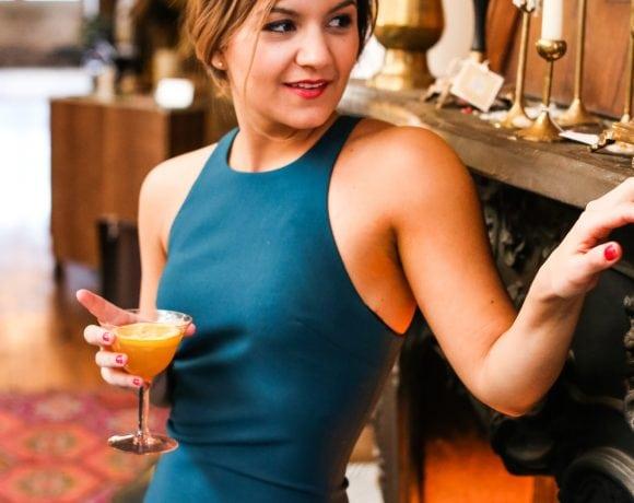 A dress, a cocktail & a fireplace