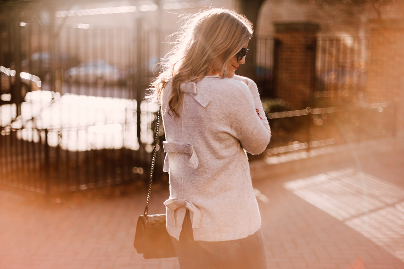 Tie back sweater with tons of bows.