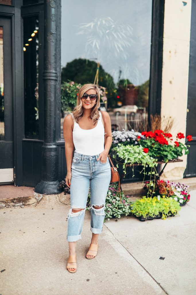 Lauren Nolan in a pair of sustainably distressed jeans