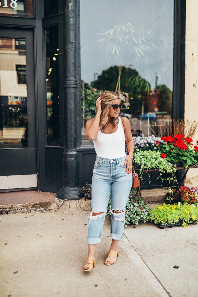 Sustainable Distressed Boyfriend Jeans + A Low Back Bodysuit outfit