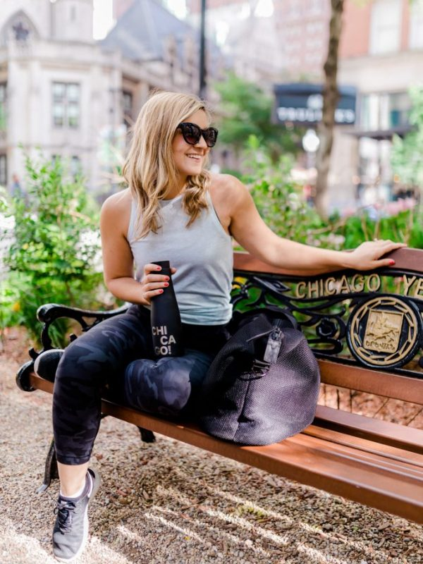 Lauren all smiles on a park bench