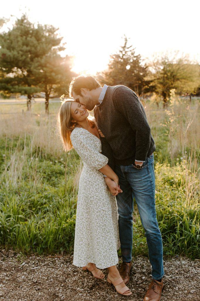 man kissing a woman on her cheeks for wedding qa