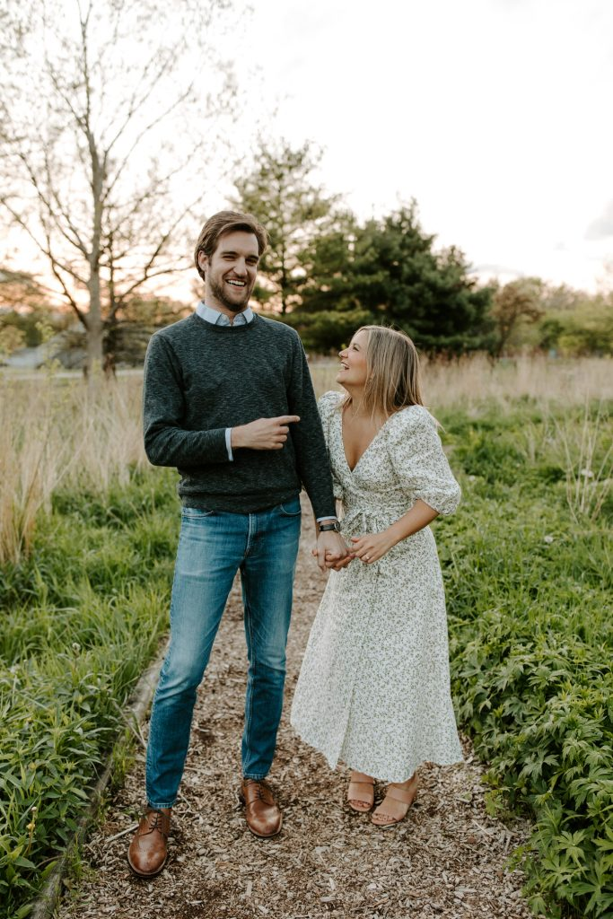 man and woman laughing for wedding qa