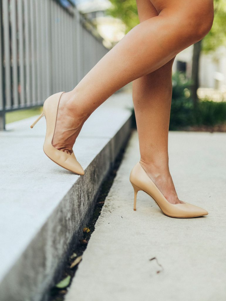 woman stepping on the stairs wearing Sarah Flint Perfect Pump