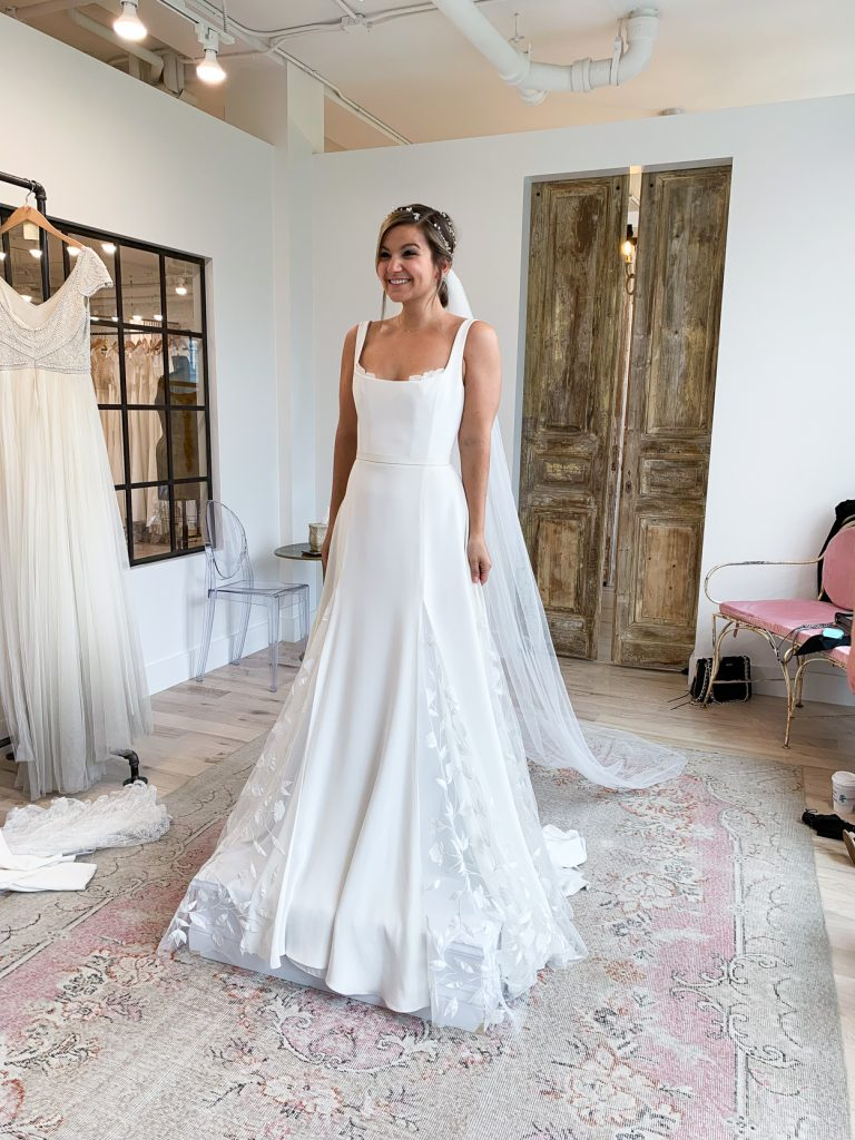 woman trying on Alexandrea Grecco Sienna Dress