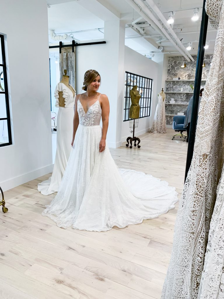 woman trying her wedding dress in a store