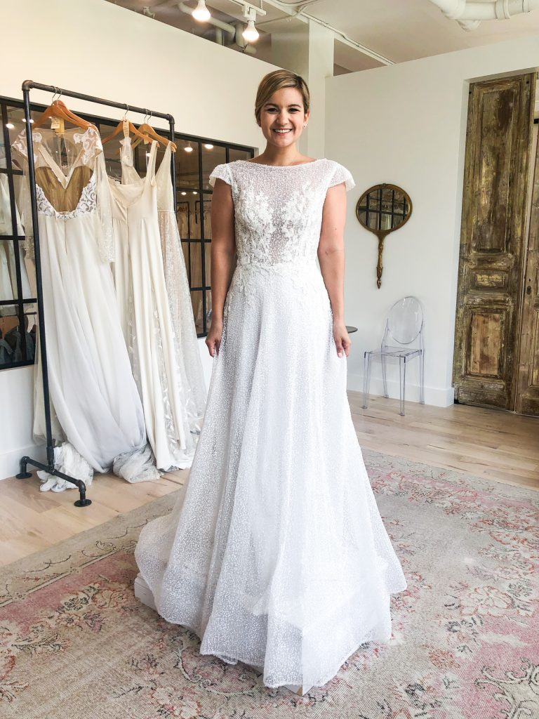 Wedding Dress Shopping Tips and woman trying on a wedding dress