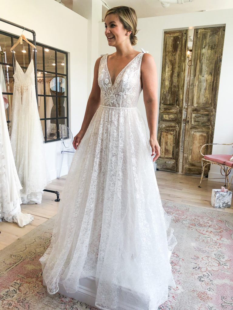 woman happy while trying on a wedding dress