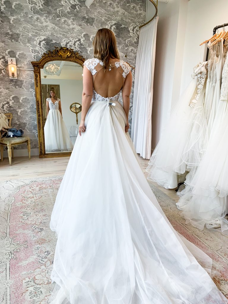 back details of a wedding dress worn by a woman
