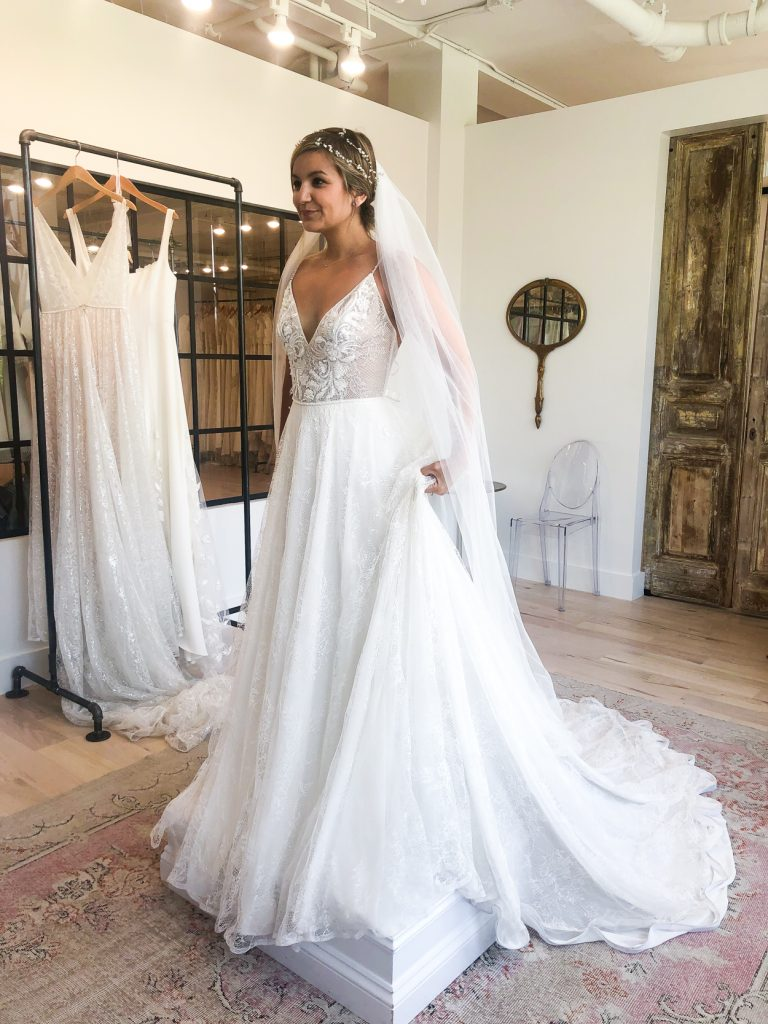 woman trying on and sharing Wedding Dress Shopping Tips