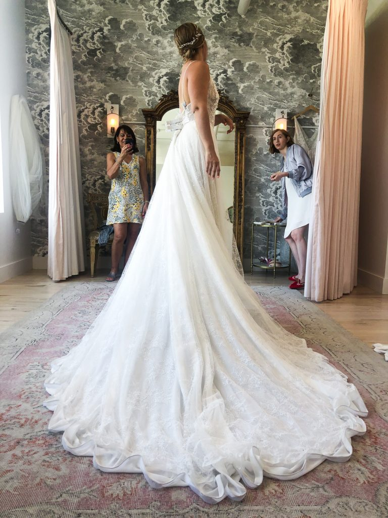 side details of wedding dress worn by a woman