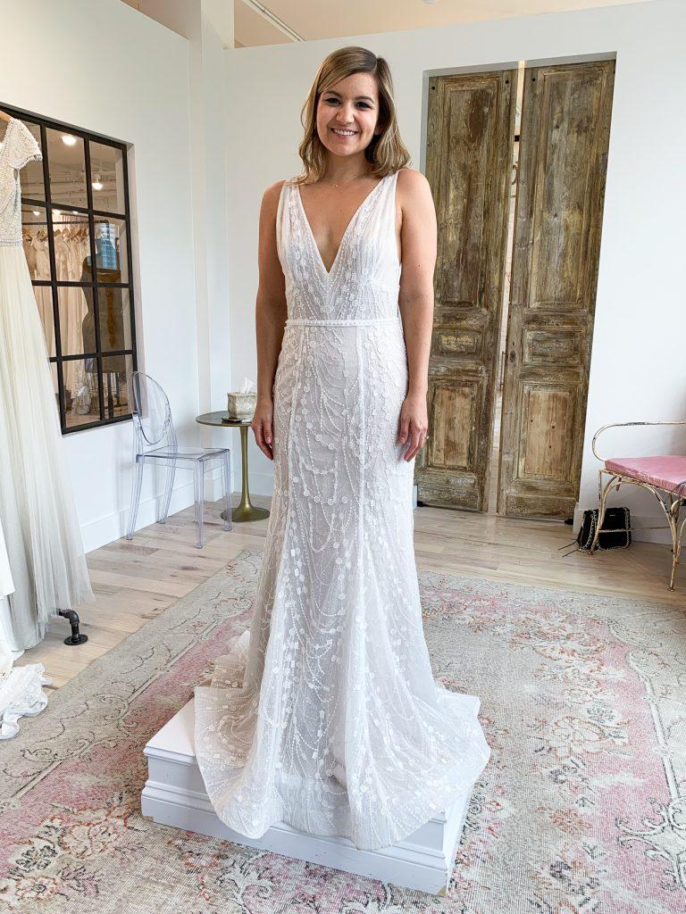woman trying on a wedding dress with mermaid cut