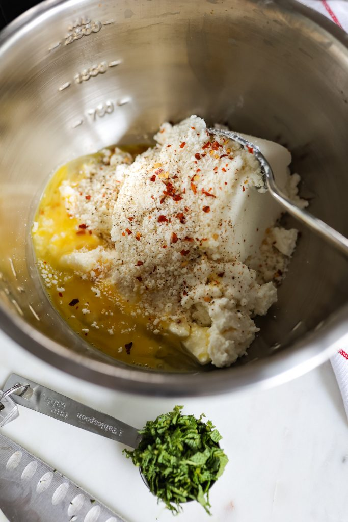 combining ricotta, parmesan, red pepper flakes, salt, pepper, and sage
