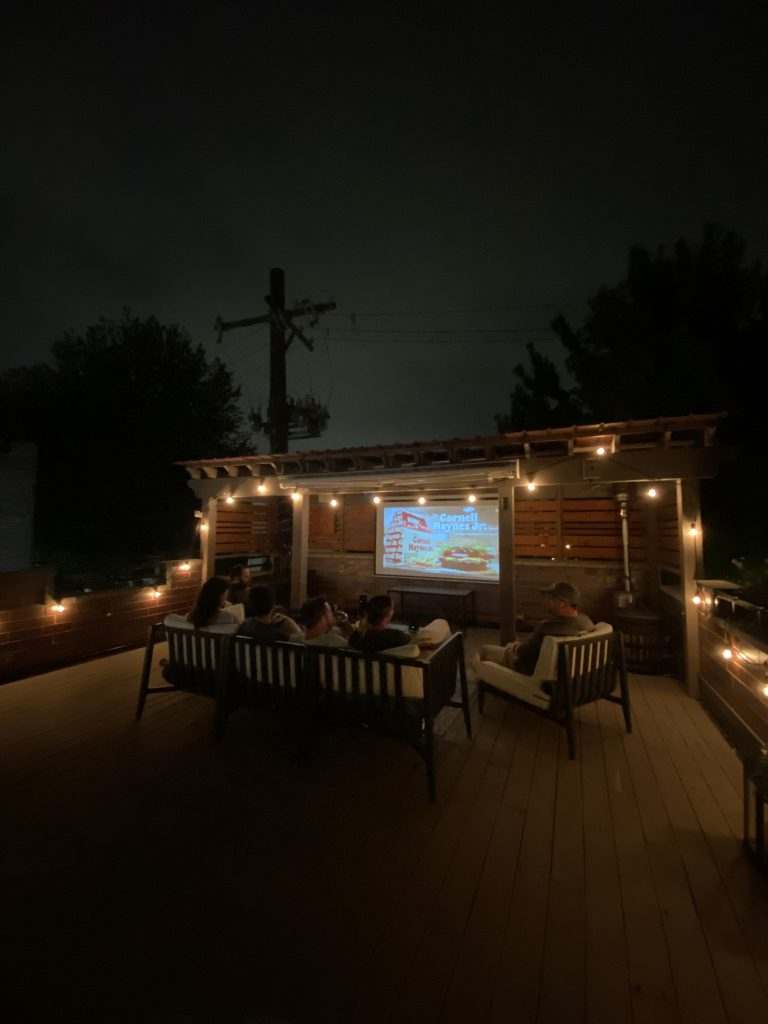 people watching movie using Affordable Outdoor Projector