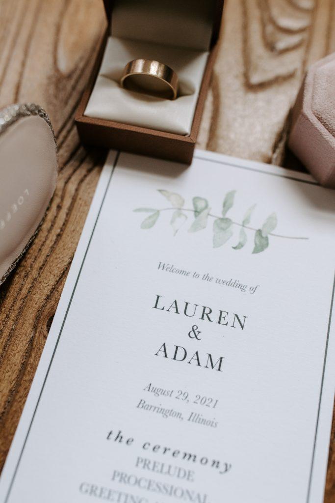 wedding ring and wedding invitation
