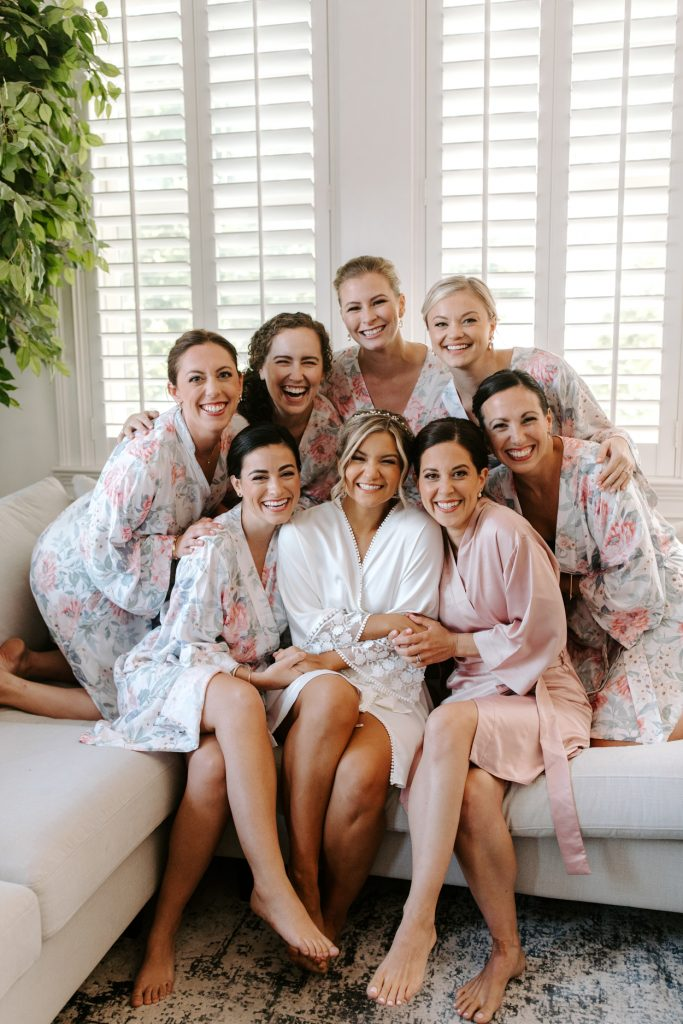 bride and bridesmaids sharing wedding purchases such as wedding robes